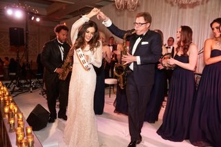 bride-in-inbal-dror-wedding-dress-dancing-with-band-saxophone-player-with-tambourine-at-wedding