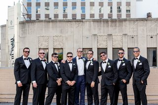 groom-in-navy-tuxedo-groomsmen-in-classic-black-tux-groom-and-groomsmen-in-sunglasses