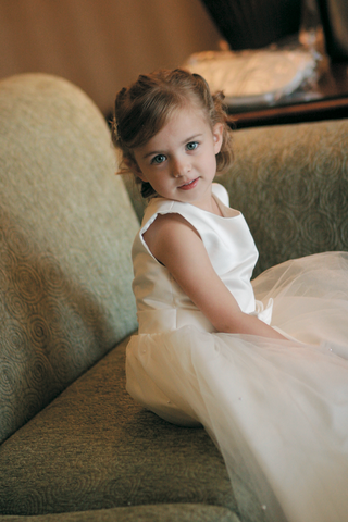 little-girl-in-ivory-dress-with-hair-pulled-back