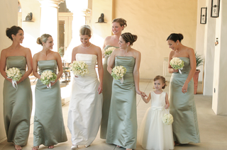flower-girl-with-bridesmaids-in-green-gowns