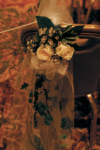 flower-and-greenery-on-backs-of-wedding-chairs