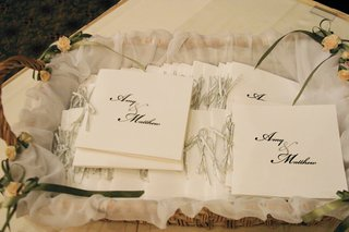 wicker-box-displaying-simple-ceremony-booklets