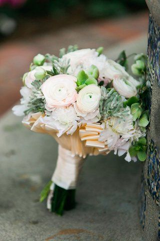 bridal-wedding-bouquet-with-greenery-verdure-pink-ranunculus-flowers-and-champagne-ribbon