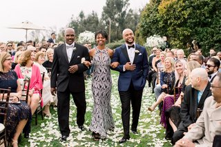 shane-vereen-nfl-player-with-mom-and-dad-at-wedding-ceremony-grass-lawn-flower-petals-groom-in-navy