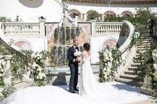 wedding-photos-first-look-bride-in-flower-marchesa-gown-mark-ingram-atelier-groom-in-tom-ford
