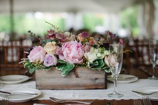 pink-peonies-purple-blossoms-lace-table-runner-greenery-wooden-planter