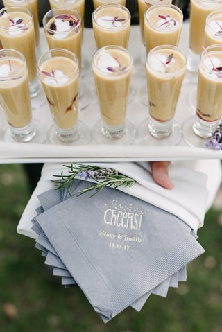 fall-wedding-cocktail-hour-inspiration-grey-cocktail-napkins-gold-writing-cheers