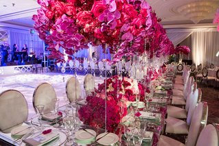velvet-and-chrome-oval-chairs-mirror-table-acrylic-stand-pink-orchid-rose-centerpiece-flowers-under