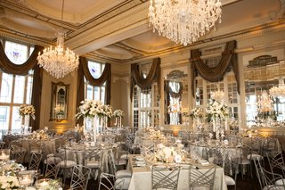 missouri-athletic-club-wedding-reception-chandeliers-silver-linens-and-chairs