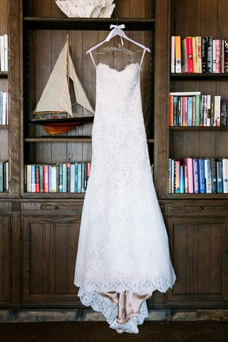alencon-lace-wedding-dress-with-sweetheart-neckline-sweep-train-on-hanger-in-library