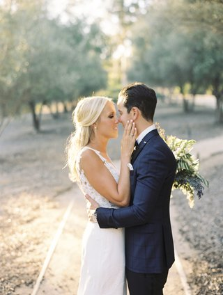 bride-in-pronovias-wedding-dress-groom-in-blue-windowpane-suit-jacket-almost-kiss
