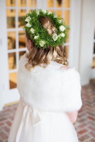 flower-girl-with-greenery-and-white-rose-flower-crown-white-fur-wrap-ivory-dress-curls-blonde