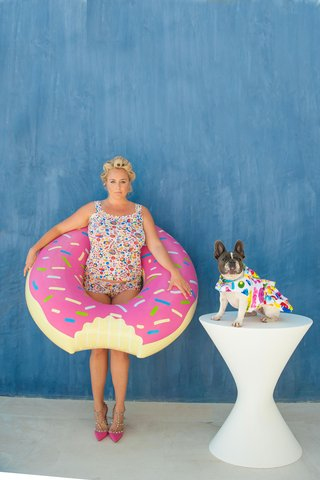 bride-with-hair-in-curlers-multi-colored-swimsuit-donut-pool-float-dog-in-swimsuit