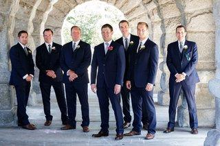 groom-and-groomsmen-in-navy-suits-blue-ties-brown-dress-shoes