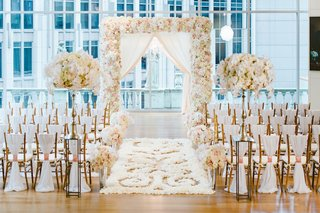 wedding-ceremony-with-city-views-and-white-blush-decor-wood-floor-with-white-petals