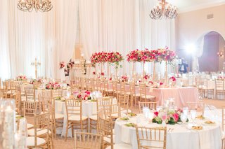 wedding-reception-ballroom-white-drapery-gold-chairs-centerpieces-hot-pink-light-pink-flowers