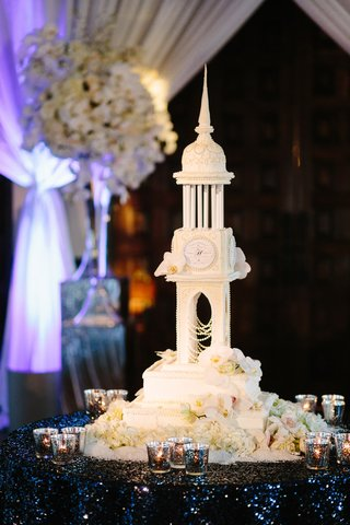 four-foot-tall-wedding-cake-modeled-after-cathedral-with-fresh-orchids-and-couples-wedding-logo