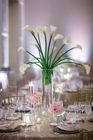 wedding-reception-centerpiece-of-calla-lilies-small-arrangements-of-pink-roses