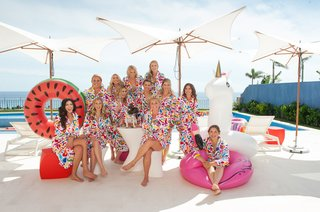 bridesmaids-in-floral-robes-by-the-pool-with-fun-inner-tubes-pool-floats