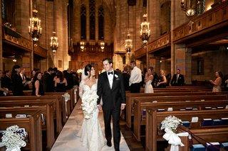 bride-in-galia-lahav-wedding-dress-walking-up-aisle-with-groom-tuxedo-gothic-revival-church-ceremony