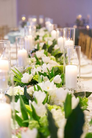white-flowers-greenery-floral-runner-with-candlelight-on-long-reception-table