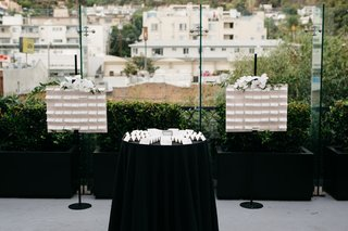 table-with-escort-cards-between-two-easel-displays-of-escort-cards