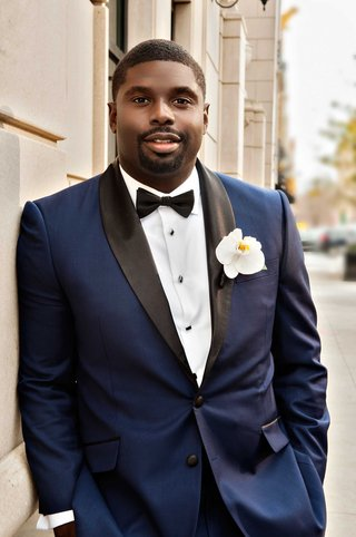 african-american-groom-with-custom-made-navy-blue-tuxedo-with-black-lapel-bow-tie-orchid-boutonniere