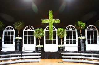 magnolia-cross-and-ficus-trees-on-wedding-stage