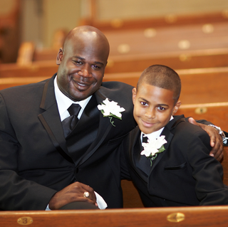african-american-ring-bearer-in-tuxedo-with-groom