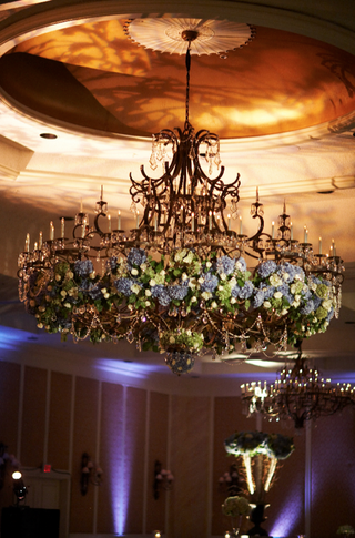 ballroom-wedding-chandelier-decorated-with-blue-green-flowers