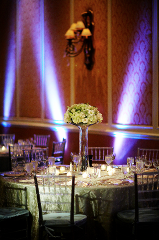 white-centerpiece-at-ballroom-reception-with-purple-lighting