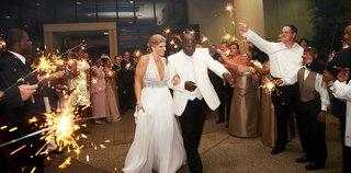 bride-in-halter-dress-and-grooms-sparkler-wedding-exit