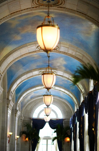 arched-ceiling-decorated-with-paintings-of-clouds