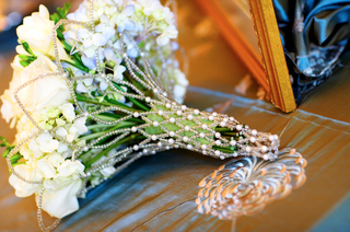 white-bouquet-inside-pearl-and-clear-bead-holder