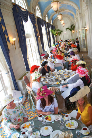 tea-party-women-guests-under-arched-painted-cloud-ceiling