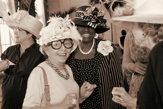 sepia-tone-picture-of-tea-party-guests-wearing-hats