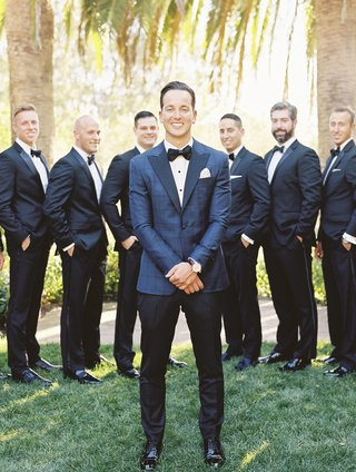 groom-in-blue-windowpane-suit-jacket-with-black-trousers-groomsmen-in-black