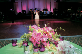 green-table-topped-with-orchids-and-candles