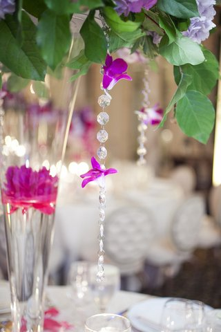 wedding-reception-centerpiece-with-greenery-floating-magenta-peony-crystal-beads-and-hot-pink-orc