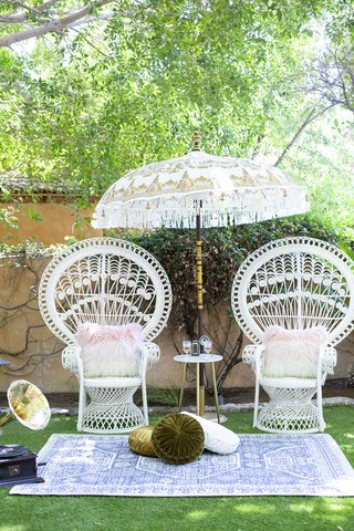 great-gatsby-inspired-garden-wedding-styled-shoot-high-back-vintage-garden-chairs-fringed-umbrella
