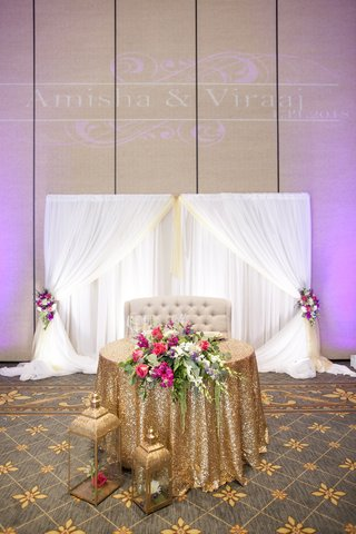 south-asian-wedding-inspiration-gold-sequin-linen-for-sweetheart-table-love-seat