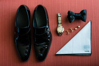 grooms-day-of-wedding-accessories-black-gucci-shoes-and-satin-bow-tie-tom-ford-pocket-square-gold