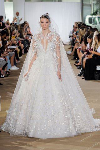 ines-di-santo-fall-2019-bridal-collection-wedding-dress-lilia-embellished-ball-gown-with-cape