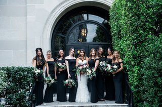 bride-in-white-dress-sweetheart-neckline-with-bridesmaids-in-black-off-shoulder-bouquets-burgundy