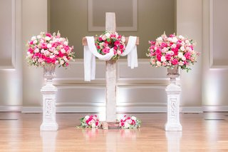 wedding-ceremony-church-altar-wood-cross-pink-white-flowers-urns