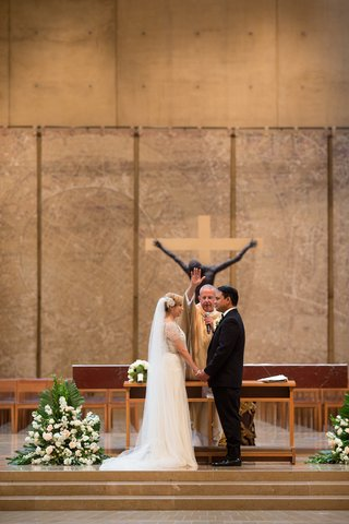 bride-and-groom-at-wedding-ceremony-in-the-cathedral-of-our-lady-of-the-angels