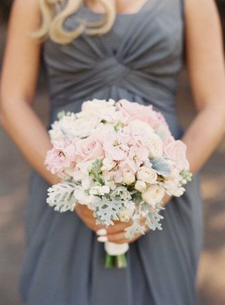 blonde-bridesmaid-in-grey-long-bridesmaid-dress-holding-bouquet-with-light-pink-rose-dusty-miller