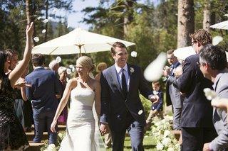 wedding-guests-throwing-petals-on-bride-and-groom
