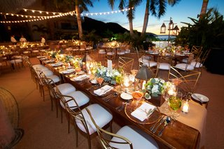 long-wood-reception-table-with-twinkle-lights-and-ocean-view