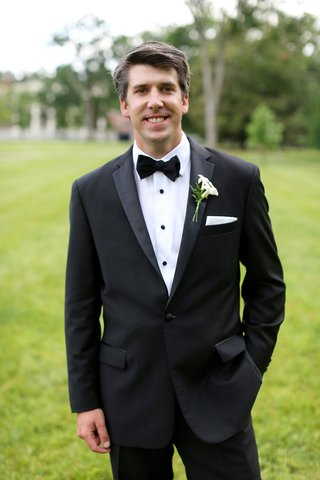 groom-in-classic-black-and-white-suit